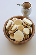 A bowl of freshly baked Alfajor cookies and Mate Tea