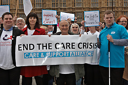 © Licensed to London News Pictures.  06/03/2012. LONDON, UK. Protesters, including Tony Robinson (pictured centre) representing 50 charities gather outside the Houses of Parliament to mass lobby of MPs about the provision of social care to elderly and other vulnerable groups. The protest follows publication of the Dilnot Report into funding social care. Photo credit :  Cliff Hide/LNP
