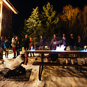 Hostel X team practice heading down the road of lighting the table on fire while passing beers to anyone willing to play with a mug of beer on fire.