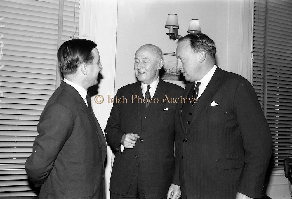12/11/1964<br /> 11/12/1964<br /> 12 November 1964<br /> <br /> Mr. John M. Gordon Charman and Joint Managing Director, mr Stephen Mackenzie Vice Chairman and Mr J.P. Jameson Joint Managing Director speaking with each other at the reception