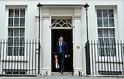 © Licensed to London News Pictures. 21/03/2012. Westminster, UK. George Osborne leaves number 11. British Chancellor of the Exchequer George Osborne holds his red ministerial box as he poses for pictures outside 11 Downing Street in London, on March 21, 2012. The Chancellor is expected to raise the amount of money people can earn before income tax takes hold and impose a new levy on the purchase of expensive homes. Photo credit : Stephen SImpson/LNP