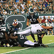 Kahlil Bell dives in for a Jets touchdown in the third quarter during the New York Jets V Philadelphia Eagles Pre Season NFL match at MetLife Stadium, East Rutherford, NJ, USA. 29th August 2013. Photo Tim Clayton