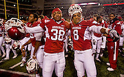 Nov 12, 2011; Fayetteville, AR, USA;  Arkansas Razorbacks cornerbacks Jerry Mitchell (38) and Tevin Mitchel (8) show off for the camera following a game against the Tennessee Volunteers at Donald W. Reynolds Razorback Stadium. Arkansas defeated Tennessee 49-7. Mandatory Credit: Beth Hall-US PRESSWIRE