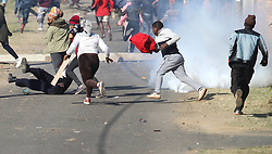 """South Africa - Durban - 21 July 2020 - Police cat and mouse chase with Lamontville informal settlements residents continues on Tuesday morning as crowds gather, blocking the roads over outages<br /> Picture"""": Doctor Ngcobo/African News Agency(ANA)"""