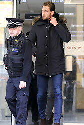 © Licensed to London News Pictures. 23/12/2019. London, UK. LEWIS BURTON, Radio presenter and Love Island host CAROLINE FLACK'S boyfriend leaves Highbury Corner Magistrates' Court after she pleaded not guilty to the charged for actual bodily harm. CAROLINE FLACK will appear before a Crown Court in March 2020 for a jury trail. Photo credit: Dinendra Haria/LNP