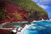 "Red sand beach in Hana, Maui, Hawaii<br /> ..... <br /> The island of Maui is the second-largest of the Hawaiian Islands and is the 17th largest island in the United States. Maui is part of the State of Hawaii and is the largest of Maui County's four islands, bigger than Molokaʻi, Lānaʻi, and unpopulated Kahoʻolawe. Wailuku is the seat of Maui County and is the third-largest CDP as of 2010. Other significant places include Kīhei (including Wailea and Makena in the Kihei Town CDP, which is the second-most-populated CDP in Maui); Lahaina (including Kāʻanapali and Kapalua in the Lahaina Town CDP); Makawao; Pāʻia; Kula; Haʻikū; and Hāna. Native Hawaiian tradition gives the origin of the island's name in the legend of Hawaiʻiloa, the navigator credited with discovery of the Hawaiian Islands. According to that legend, Hawaiʻiloa named the island of Maui after his son, who in turn was named for the demigod Māui. The earlier name of Maui was ʻIhikapalaumaewa. The Island of Maui is also called the ""Valley Isle"" for the large isthmus between its northwestern and southeastern volcanoes and the numerous large valleys carved into both mountains."