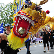 BATH, Maine -- 7/4/15 -- Quinn Blaiklock of Arrowsic leads the Chinese dragon display created by Five Elements Mountain Martial Arts Fitness Center during the Bath Heritage Days Parade on Saturday. Photo © 2015 Roger S. Duncan
