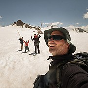Family portrait during a trekking at high altitude in the mountains over a glacier.