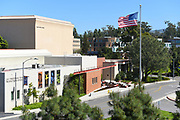 The Claire Trevor School of the Arts and American Flag on the Campus of the University of California Irvine