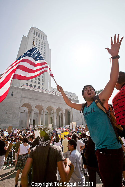 Occupy LA marching through the financial district of Los Angeles to L.A city hall. Hundreds of marches are taking part around the globe on an international day of action.