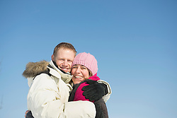 Portrait of couple in winter, smiling, Bavaria, Germany