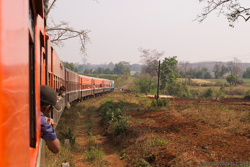 A train passes fields in Myanmar.