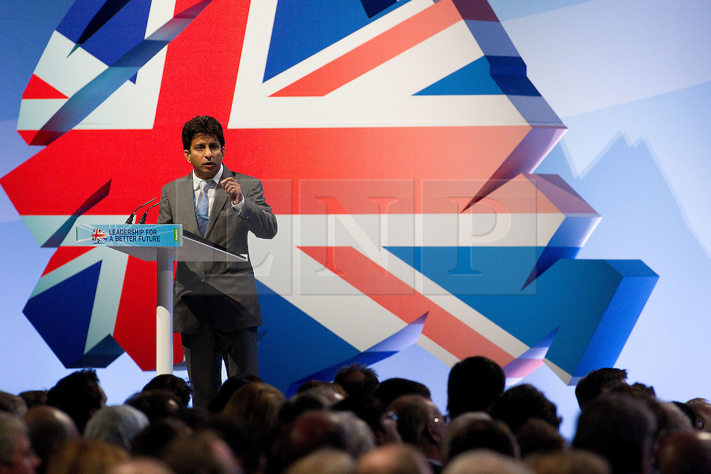"© Licensed to London News Pictures. 03/10/2011. Manchester, UK. A delegate raises a question during a panel on ""Rebalancing the Economy"" in front of an audience at the Conservative Party Conference in Manchester. Photo credit : Joel Goodman/LNP"