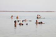 Israel, Dead Sea People float in the heavy water of the Dead Sea