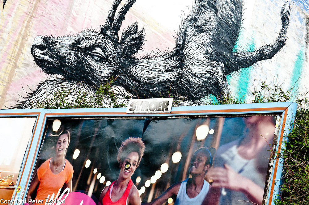 Billboards and wall graffiti in Berlin, Germany