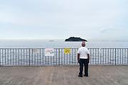 person looking at Sarushima Island from Umikaze park, Yokosuka with Tokyo Bay