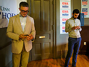 25 APRIL 2019 - CEDAR RAPIDS, IOWA: Elizabeth Warren's campaign workers wait for a campaign event to start at the Linn Phoenix Club in Cedar Rapids. The Linn Phoenix Club is an organization that promotes Democratic candidates in Linn County, Iowa. Sen. Warren is campaigning in eastern Iowa Thursday night and Friday. Iowa traditionally hosts the the first selection event of the presidential election cycle. The Iowa Caucuses will be on Feb. 3, 2020.            PHOTO BY JACK KURTZ