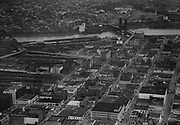 """Ackroyd 01907-1. """"aerials of northwest business district including Broadway and Burnside bridges. December 14, 1949"""" (NW Portland, Pearl District, Old Town)"""