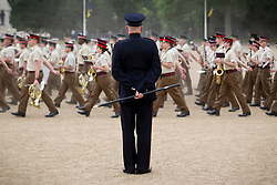 © Licensed to London News Pictures. 10/06/2013. London, UK. Garrison Sargent Major (GSM) William 'Billy' Mott watches over the Massed Bands of the British Army's Household Division as they carry out a dress rehearsal ahead of the annual Beating Retreat ceremony in London today (10/06/2013). The musical event, which takes place on Horse Guards Parade, will be held on the 12th and 13th of June this year, with Prince Philip and the Queen attending. Photo credit: Matt Cetti-Roberts. Photo credit: Matt Cetti-Roberts/LNP