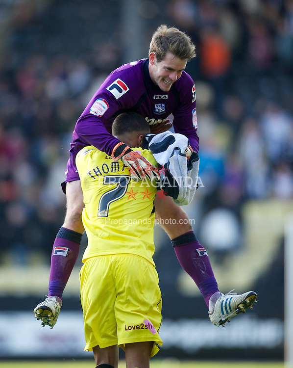 NOTTINGHAM, ENGLAND - Saturday, October 6, 2012: Tranmere Rovers' goalkeeper Owain Fon Williams celebrates with match-winning goal-scorer Joe Thompson at the final whistle as his side beat Notts County 1-0 to remain top of the table during the Football League One match at Meadow Lane. (Pic by David Rawcliffe/Propaganda)