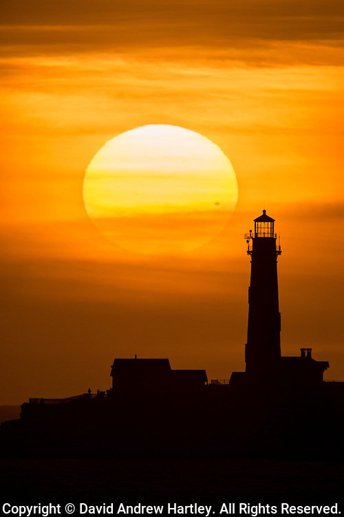 Pigeon Point Lighthouse silhouetted in the setting sun during the transit of Venus, California