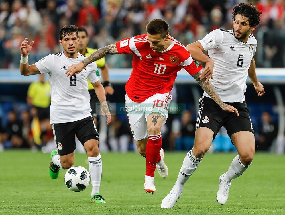 June 19, 2018 - Saint Petersburg, Russia - Fedor Smolov (C) of Russia national team vies for the ball with Tarek Hamed (L) and Ahmed Hegazy of Egypt national team during the 2018 FIFA World Cup Russia group A match between Russia and Egypt on June 19, 2018 at Saint Petersburg Stadium in Saint Petersburg, Russia. (Credit Image: © Mike Kireev/NurPhoto via ZUMA Press)