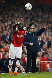 Man City Manager Manuel Pellegrini (CHI) points as Arsenal Defender Bacary Sagna (FRA) takes a throw in - Photo mandatory by-line: Rogan Thomson/JMP - 07966 386802 - 29/03/14 - SPORT - FOOTBALL - Emirates Stadium, London - Arsenal v Manchester City - Barclays Premier League.