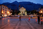 Town square, Kacicev trg, after sunset, with Biokovo National Park in background. Makarska, Croatia