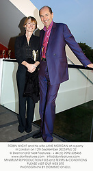 ROBIN WIGHT and his wife JANE MORGAN at a party in London on 12th September 2003.PMJ 32