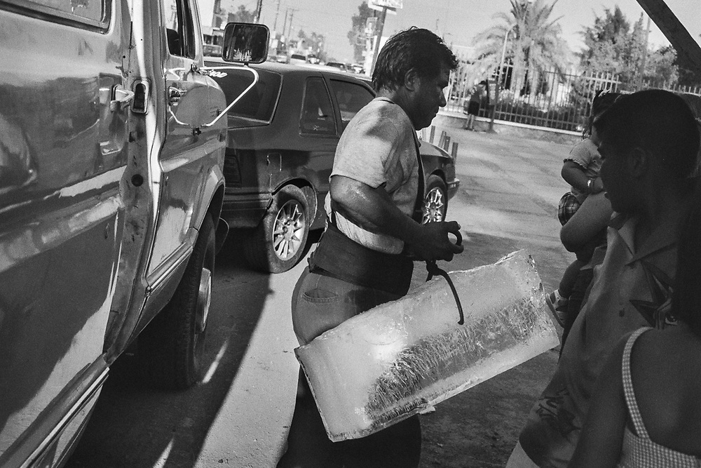 Ice delivery on a hot day in town.