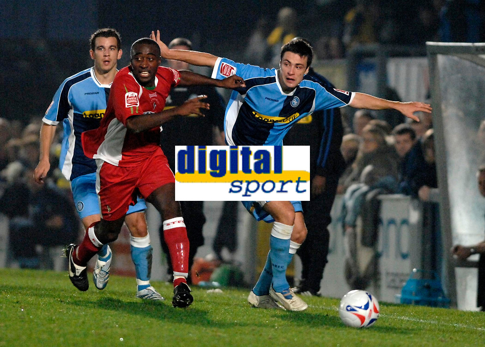 Photo: Richard Lane.<br />Wycombe Wanderers v Swindon Town. Johnstone's Paint Trophy. 17/10/2006. <br />Swindon's Aaron Brown is challenged by Wycombe's Russell Martin.