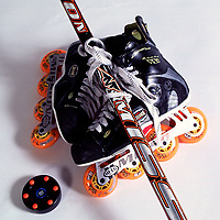 Pair of Mission inline roller hockey skates, stick and puck