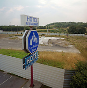 The remains of the former Hôtelissimo Les Relais Bleus Hotel, where the Air France Concorde airliner crashed on 25 July 2000. Now a flattened site, it is screened off from passers-by from a nearby road near Le Bourget airport - where the pilots of the stricken supersonic aircraft were trying to make for before it stalled and fell on this spot. One hundred passengers and nine crew members on board the flight died. On the ground, four people were killed and one seriously injured.