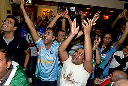 © under license to London News Pictures. 2.4.11.The Indian community in The Regency Club, Kingsbury NW London celebrate beating Sri Lanka in the Cricket World Cup Final by six wickets..