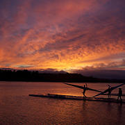 Rowers prepare to row during a beautiful sunrise on Lake Karapiro, near Cambridge, Waikato. Many national and international rowing competitions are held on Lake Karapiro which is also the home of The Rowing New Zealand High Performance Centre. Lake Karapiro hosted the 2010 World Rowing Championships. Lake Karapiro, Waikato,  New Zealand. 15th December 2010. Photo Tim Clayton