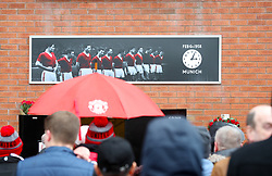 Fans look at a tribute to the Munich air disaster ahead of the Premier League match at Old Trafford, Manchester.