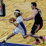 ORLANDO, FL - APRIL 12: Cole Anthony #50 of the Orlando Magic drives past Drew Eubanks #14 of the San Antonio Spurs during the second half at Amway Center on April 12, 2021 in Orlando, Florida. NOTE TO USER: User expressly acknowledges and agrees that, by downloading and or using this photograph, User is consenting to the terms and conditions of the Getty Images License Agreement. (Photo by Alex Menendez/Getty Images)*** Local Caption *** Cole Anthony; Drew Eubanks