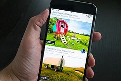 Airbnb holiday room booking app showing gypsy style wagons for rent on an iPhone 6 plus smart phone