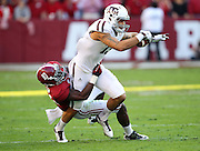 TUSCALOOSA, AL - NOVEMBER 10:  Wide receiver Mike Evans #13 of the Texas A&M Aggies is tackled by cornerback John Fulton #10 of the Alabama Crimson Tide during the game at Bryant-Denny Stadium on November 10, 2012 in Tuscaloosa, Alabama.  (Photo by Mike Zarrilli/Getty Images)