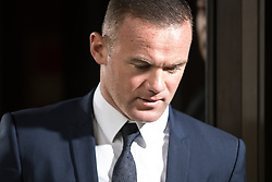 © Licensed to London News Pictures . 18/09/2017 . Stockport , UK . Everton footballer WAYNE ROONEY leaves Stockport Magistrates Court where he faced a drink-driving charge . The former England and Manchester United captain was arrested by police whilst driving in Wilmslow in Cheshire during the early hours of 1st September . Photo credit: Joel Goodman/LNP