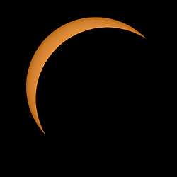 August 21, 2017 - Northern Cascades National Park, Washington - The Moon is seen passing in front of the Sun during a solar eclipse from Ross Lake, Northern Cascades National Park, Washington on Monday, Aug. 21, 2017. A total solar eclipse swept across a narrow portion of the contiguous United States from Lincoln Beach, Oregon to Charleston, South Carolina. A partial solar eclipse was visible across the entire North American continent along with parts of South America, Africa, and Europe.  ry Credit: Bill Ingalls / NASA via CNP (Credit Image: © Bill Ingalls/CNP via ZUMA Wire)