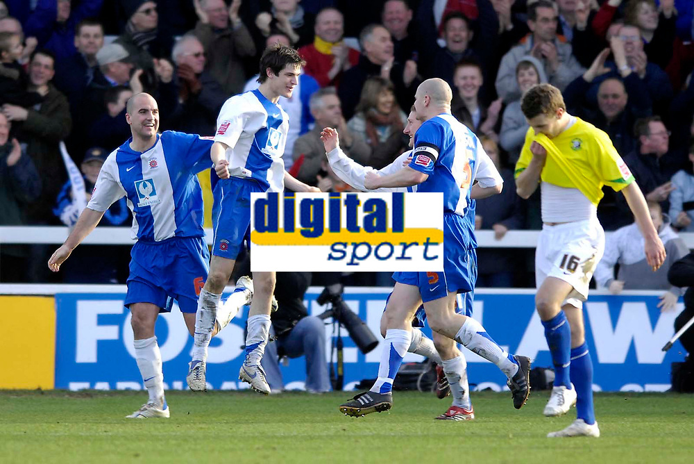 Photo: Jed Wee/Sportsbeat Images.<br /> Hartlepool United v Hereford United. Coca Cola League 2. 03/03/2007.<br /> <br /> Hartlepool celebrate with goalscorer James Brown (2nd L) as Hereford's Andy Williams wonders what went wrong.