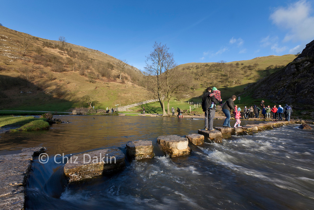 Walkers on the stepping stones at Dovedale. Image shot with Sigma 12-24mm lens at 16mm to include all of the stepping stones from one end to another.