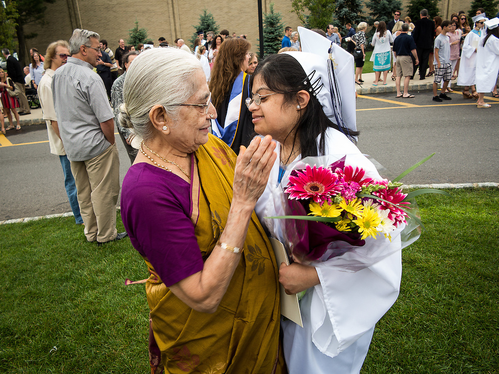 West Long Branch, New Jersey: Hema Ramaswamy receives congratualtions from her grandmother, visiting from Chennai, India, as she graduates from Middletown High School South in a ceremony at Monmouth University on June 14, 2012.