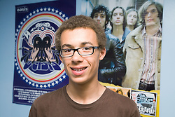 Portrait of a teenage boy in his bedroom,