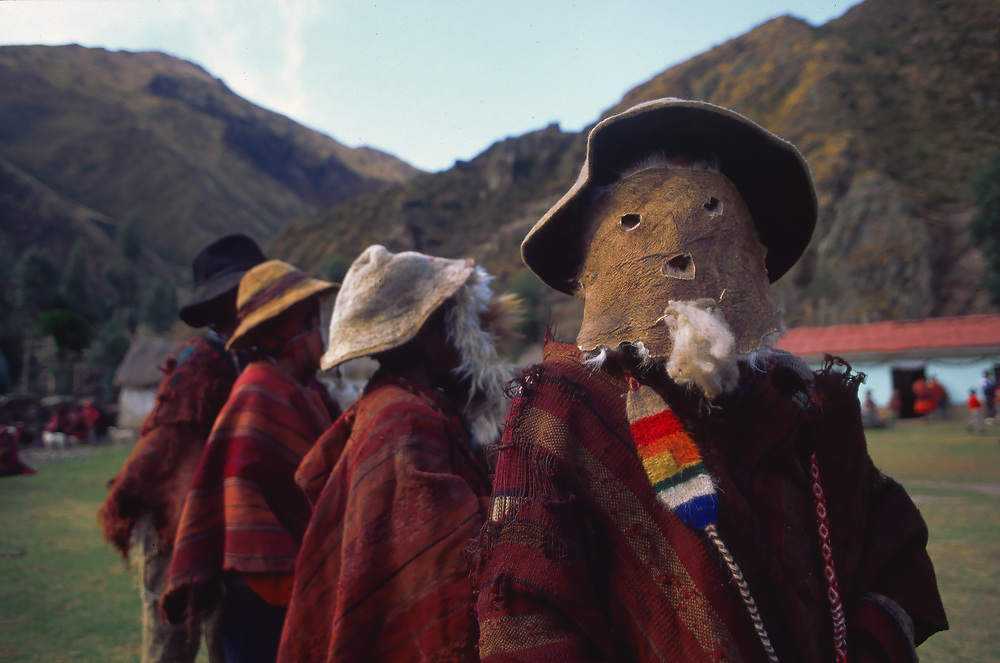 """Los Viejitos (children dress as """"old men""""). Huilloc villagers in their traditional red dress on their annual day, near Ollantaytambo, Cuzco region, Peru"""
