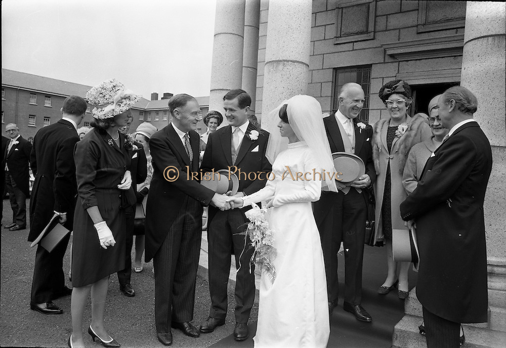 05/07/1967<br /> 07/05/1967<br /> 05 July 1967<br /> Wedding of George Walsh, eldest son of Mr and Ms Kevin G. Walsh, St. Rita's, Firhouse Road, Templeogue, Co. Dublin and Miss Arlene McMahon, elder daughter of Det. Chief Supt. Philip McMahon, Head of Special Branch, Dublin Castle and Mrs McMahon of Lisieux, Templeville Park, Templeogue, Co. Dublin who were married at the Carmelite Church, Terenure College, Dublin. An Taoiseach Mr Jack Lynch and Mrs Lynch; Mr Liam Cosgrave, leader Fine Gael and Mrs Cosgrave were among the 120 guests. Rev Fr H.E. Wright, O. Carm., Moate, officiated at the ceremony. The reception was held at Downshire Hotel, Blessington, Co. Wicklow. The couple being congratulated by Mr and Mrs Cosgrave after the ceremony.