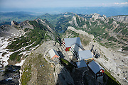 Berggasthaus Alter Säntis is perched dramatically atop Säntis (2502 m / 8218 feet), the highest peak of the Alpstein range and the Appenzell Alps, located in northeast Switzerland, Europe. Shared by three cantons, Säntis can be reached easily via aerial tramway (Luftseilbahn) from Schwägalp, or with effort via wonderful trails, to see vast mountain views across six countries: Switzerland, Germany, Austria, Liechtenstein, France and Italy. We highly recommend staying overnight on top of Säntis as we did at Berggasthaus Alter Säntis, a fifth-generation family-run mountain inn since 1850, offering modern private double and dormitory lodging with good food and magnificent views. From where we joined it at Rotsteinpass, the spectacular, rocky Lisengrat trail to Säntis is rigged with safety cables in case of icy or wet conditions (and can be scary for those with fear of heights). In rainy weather the next day, we took the easy tram down to Schwägalp instead of hiking to Ebenalp. The Appenzell Alps rise between Lake Walen and Lake Constance.