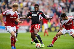 Bristol City Midfielder Jay Emmanuel-Thomas (ENG) is challenged by Swindon Midfielder Yaser Kasim (IRQ) during the first half of the match - Photo mandatory by-line: Rogan Thomson/JMP - Tel: 07966 386802 - 21/09/2013 - SPORT - FOOTBALL - County Ground, Swindon - Swindon Town v Bristol City - Sky Bet League 1.