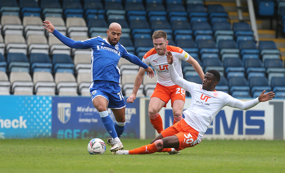 Gillingham's Jordan Graham is challenged by Blackpool's Beryly Lubala and Oliver Turton<br /> <br /> Photographer Rob Newell/CameraSport<br /> <br /> The EFL Sky Bet League One - Gillingham v Blackpool - Saturday 26th September 2020 - Priestfield Stadium - Gillingham<br /> <br /> World Copyright © 2020 CameraSport. All rights reserved. 43 Linden Ave. Countesthorpe. Leicester. England. LE8 5PG - Tel: +44 (0) 116 277 4147 - admin@camerasport.com - www.camerasport.com